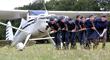 A group of air cadets demonstrate the strength of wet wipes by using them to pull a plane.