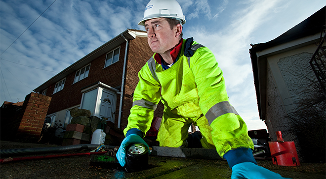 Man installing meter into ground